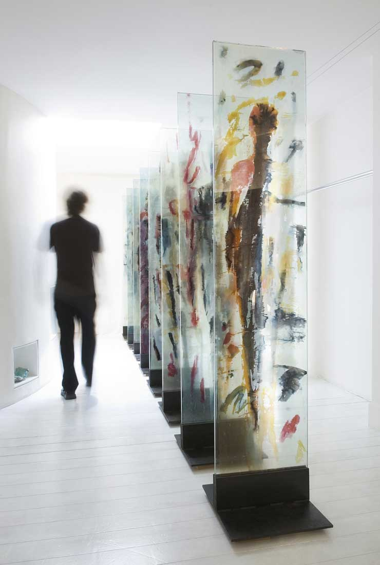 A sequence of eight freestanding glass panels in steel plinths with encapsulated hand painted silk