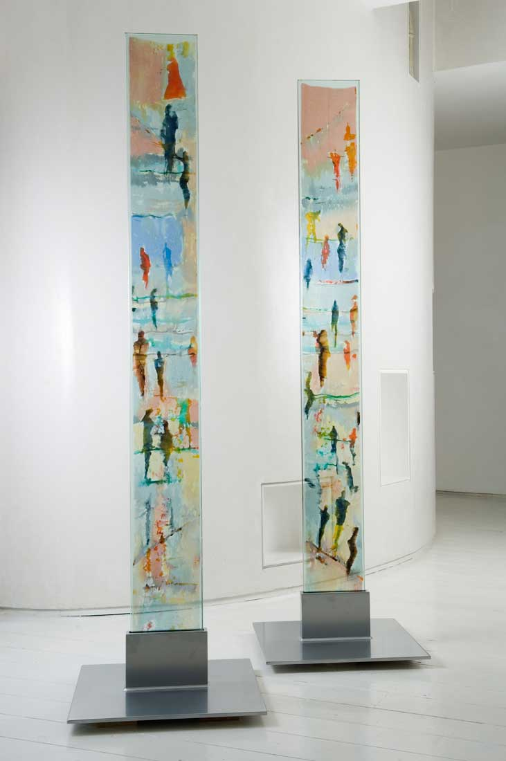 A pair of narrow freestanding glass panels on steel plinths with encapsulated hand painted silks