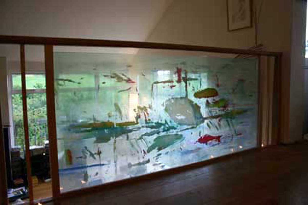 A glass balcony panel with encapsulated hand painted silks