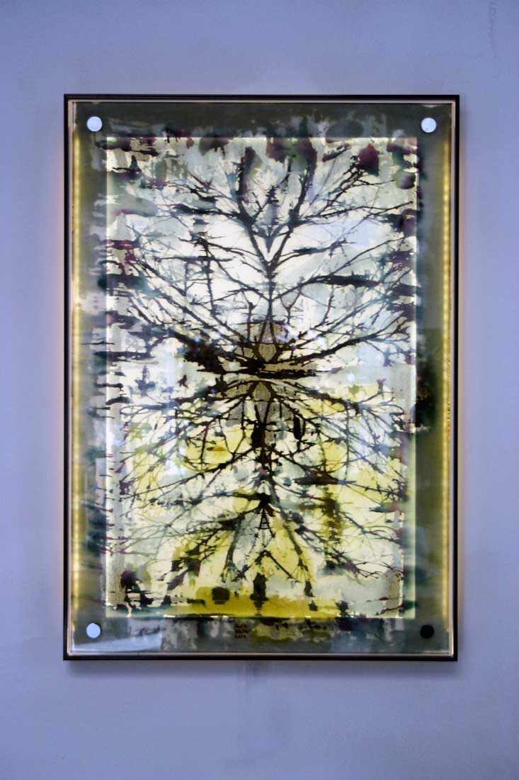 Illuminated glass panel with encapsulated hand painted silk