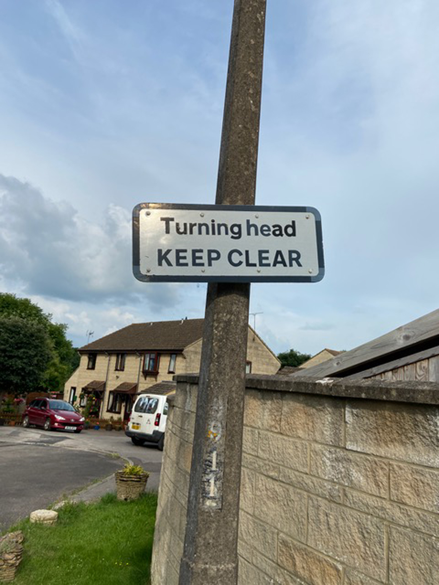 Turng Head Keep Clear road sign fixed to a lamp post